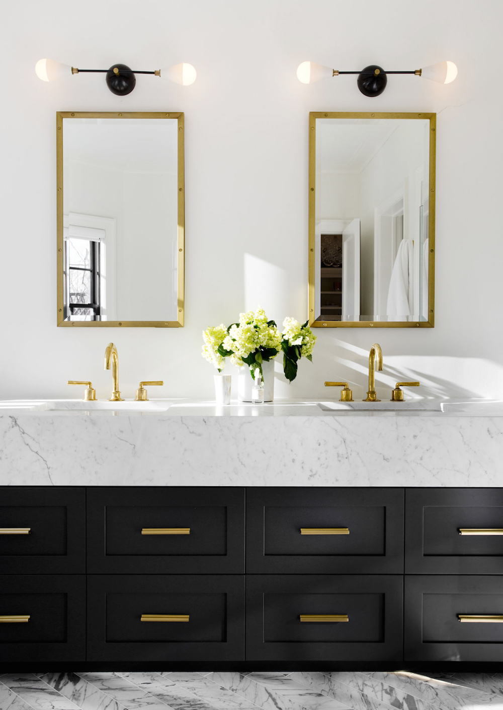 Double Marble Vanity With Gold Fixtures