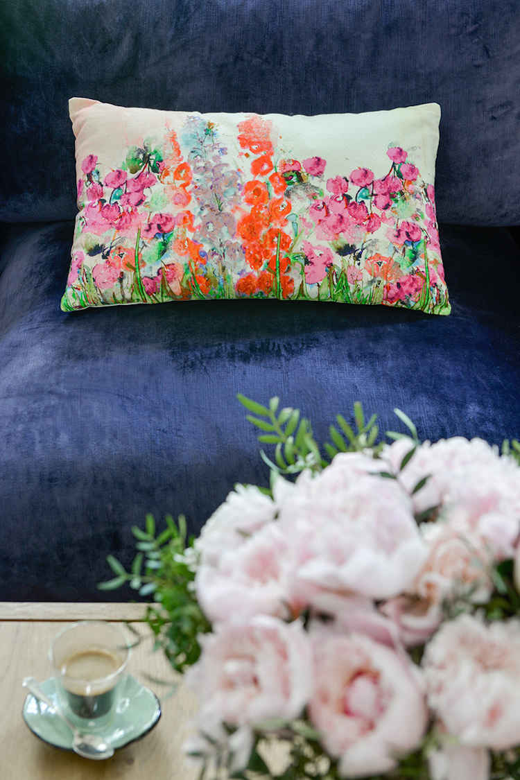 Floral Pillow on Navy Blue Couch
