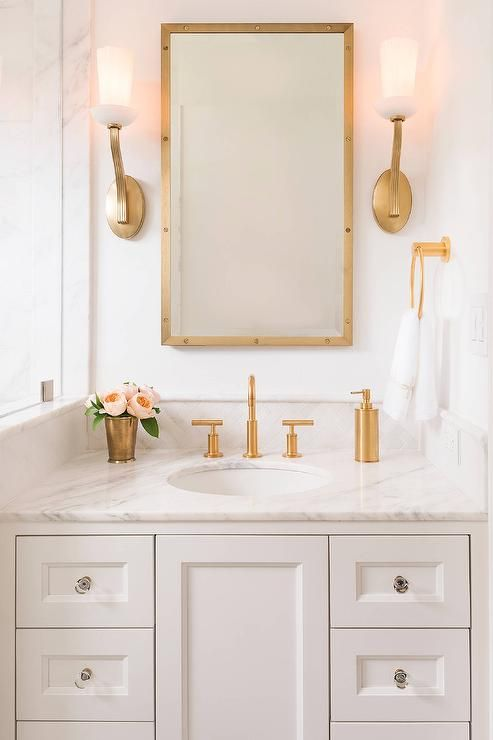 Beau Gold Fixtures On Marble Vanity With Mirror And Double Sconces