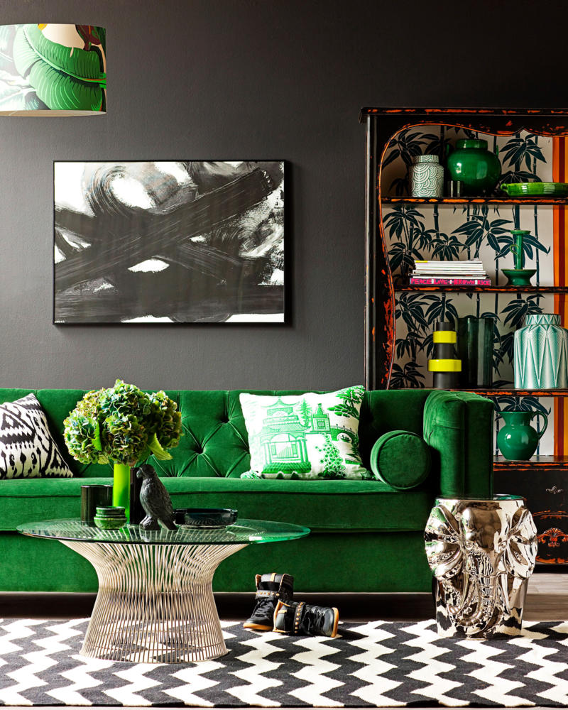 Green Velvet Sofa against Black Wall