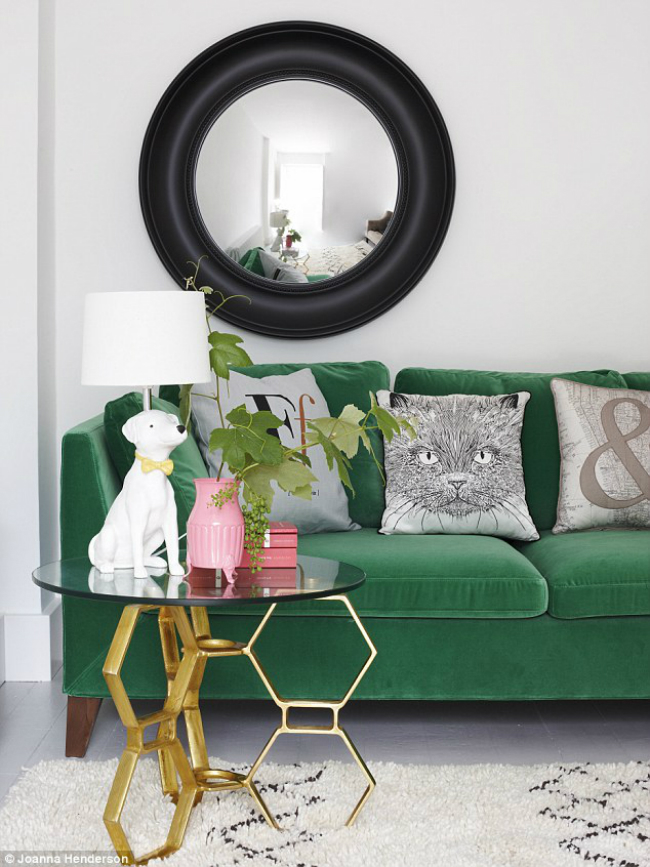 Green Velvet Sofa with Dog Lamp and Cat Pillow
