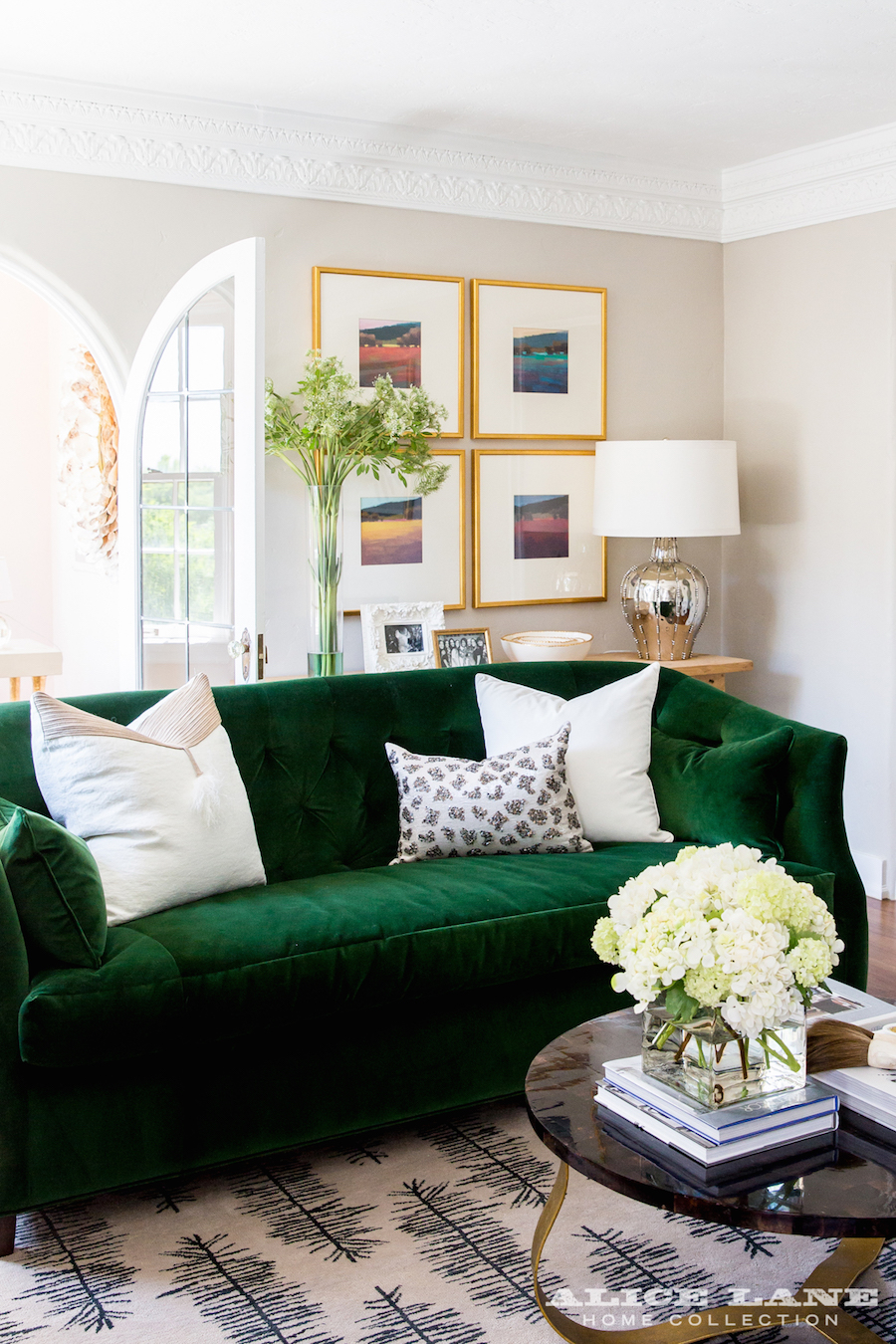 Green Velvet Sofa with White pillows