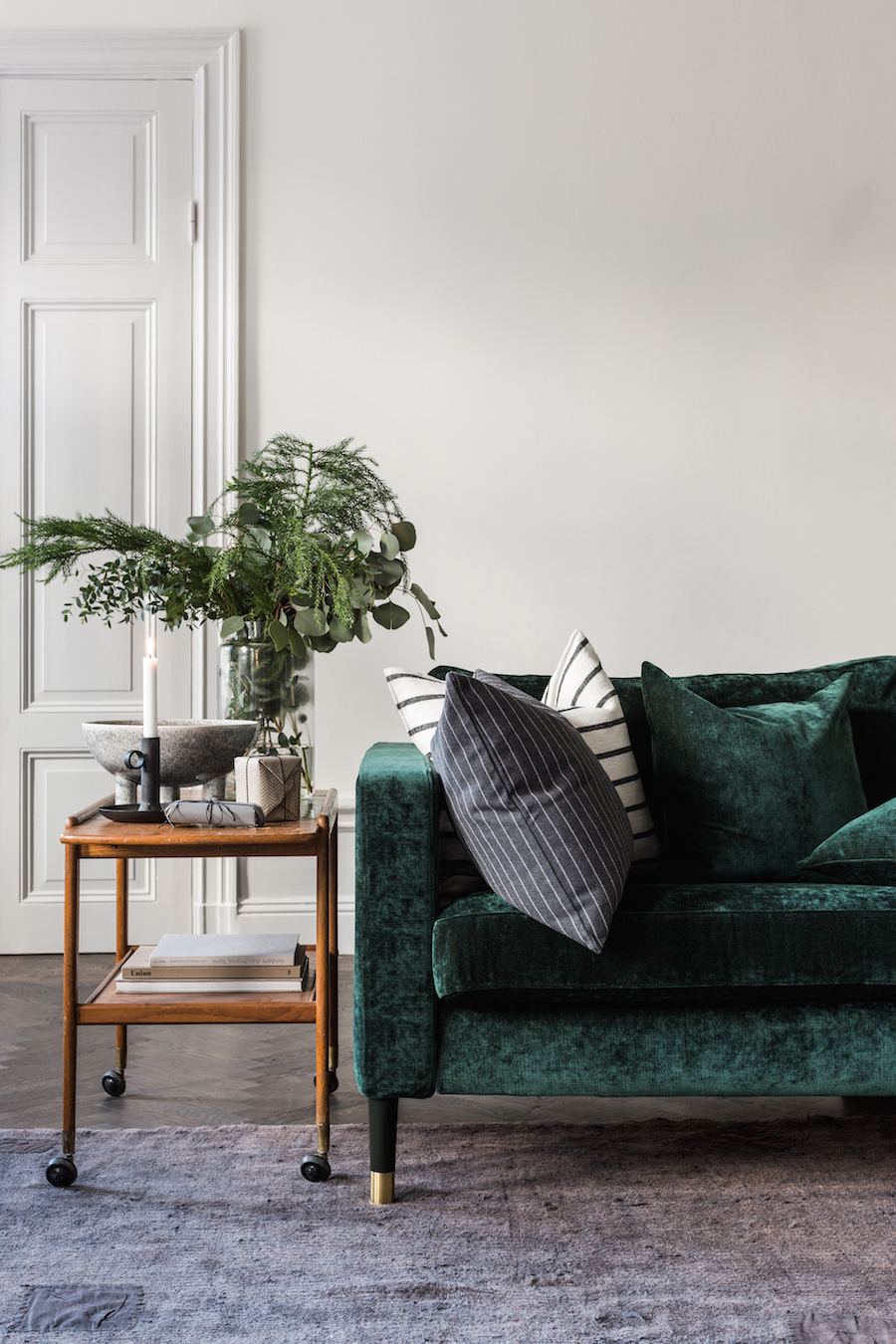 Green Velvet Sofa with Wood Side Table