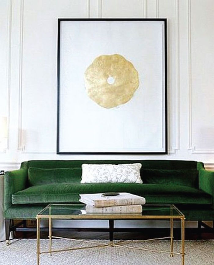 Green velvet sofa with gold art