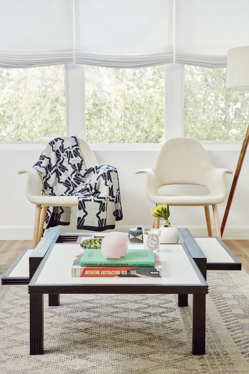 Jacey Duprie's Living Room with Double White Sitting Chairs via Damsel in Dior