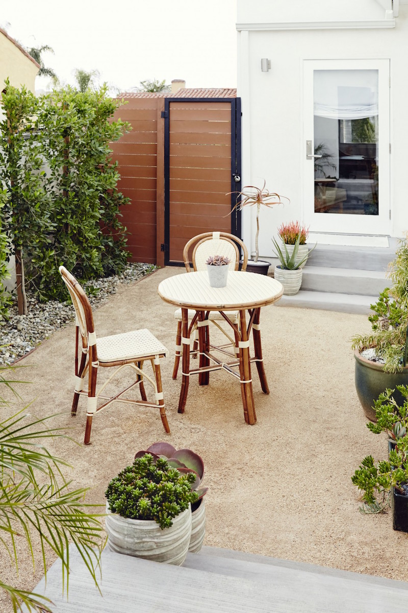 Jacey Duprie's Outdoor Space with French Rattan Bistro Chairs via Damsel in Dior