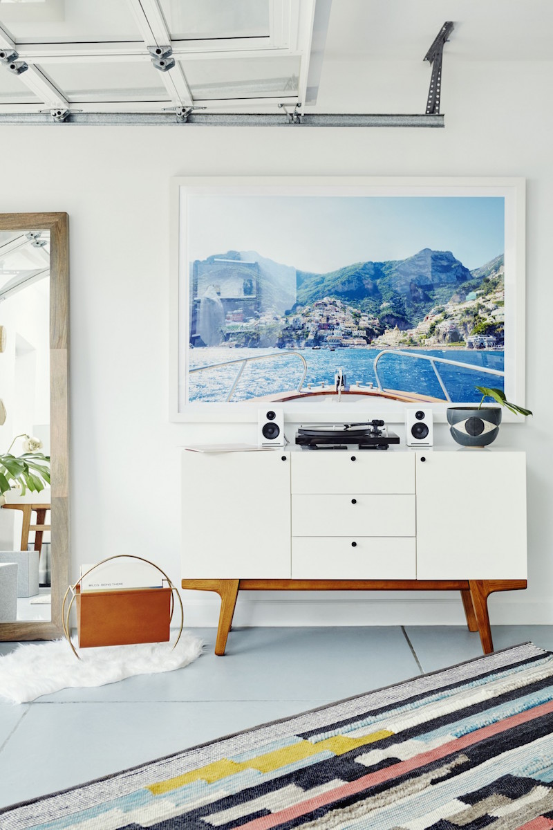Jacey Duprie's White Sideboard and Multi-Color Rug via Damsel in Dior