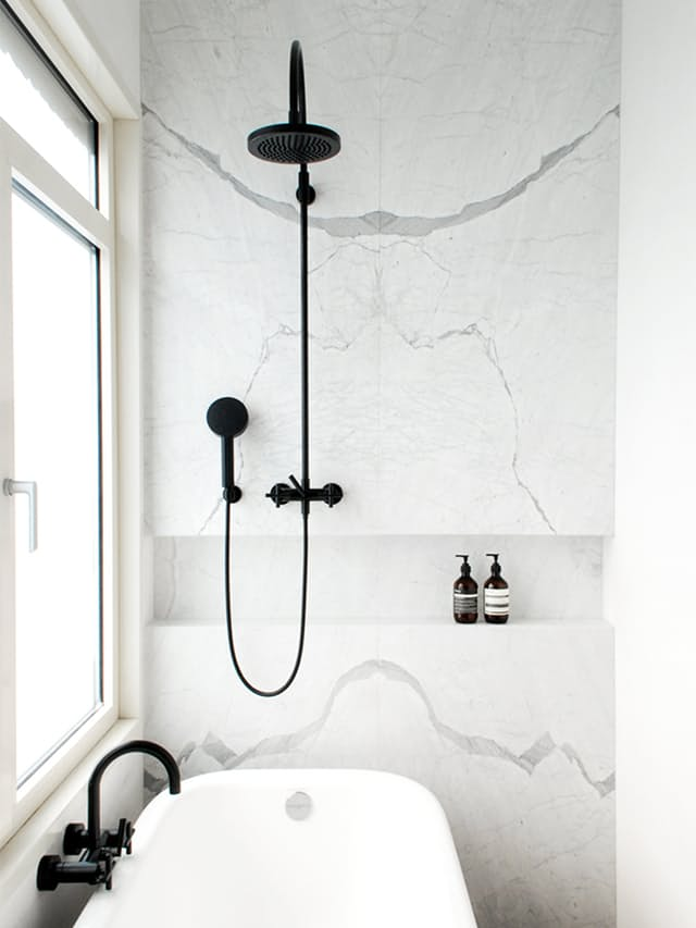 Marble Bathroom Tub with Black Fixtures
