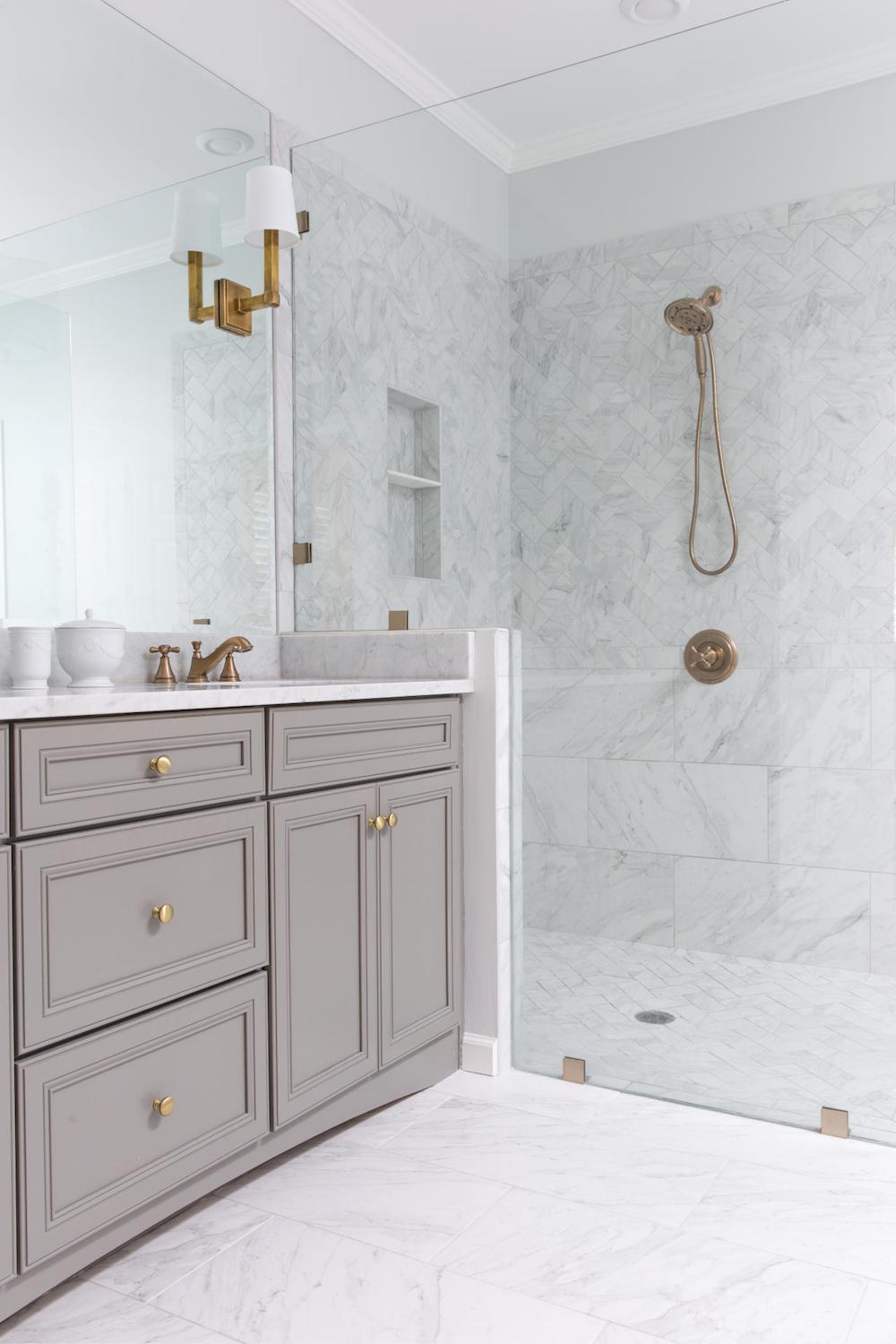 Brass sconces in bathroom via HGTV
