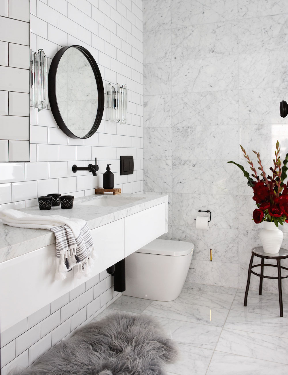 Marble Bathroom with Gray Fur Rug and Black Fixtures