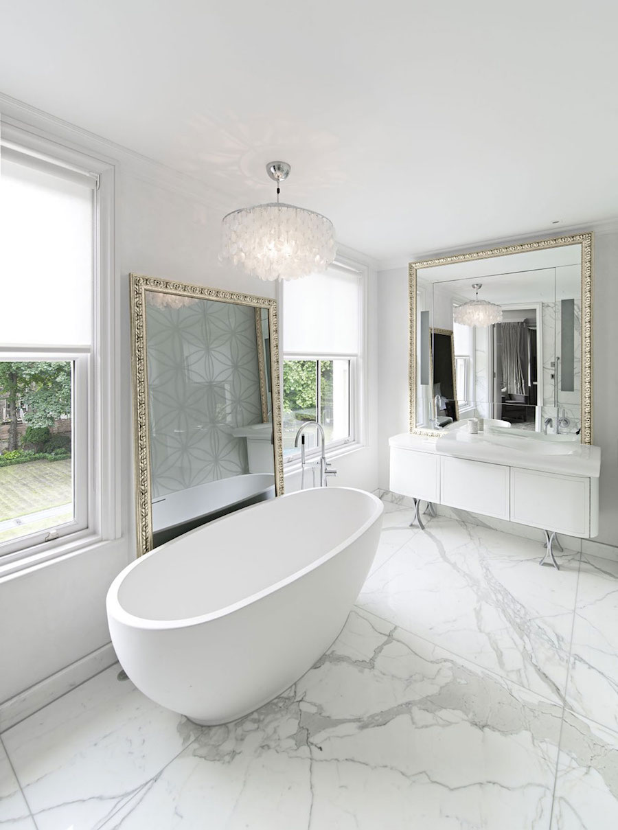 Marble Bathroom with White Tub and Gold Frame Mirrors