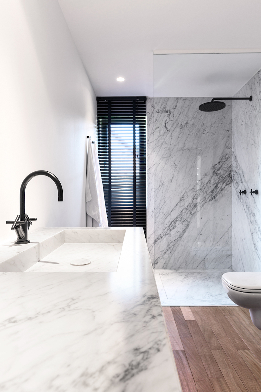 Marble Bathroom with Wood Floor