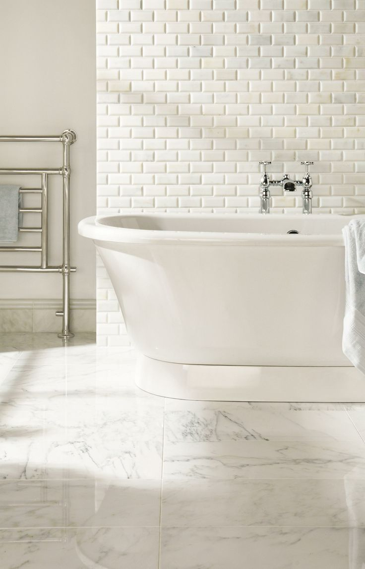 Marble Floor bathroom with tub and Subway Tiling