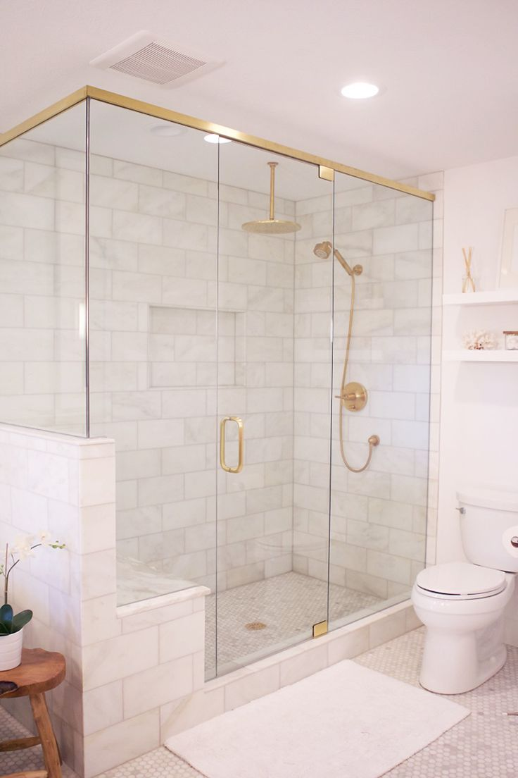 Marble Shower with Glass Doors lined in Brass