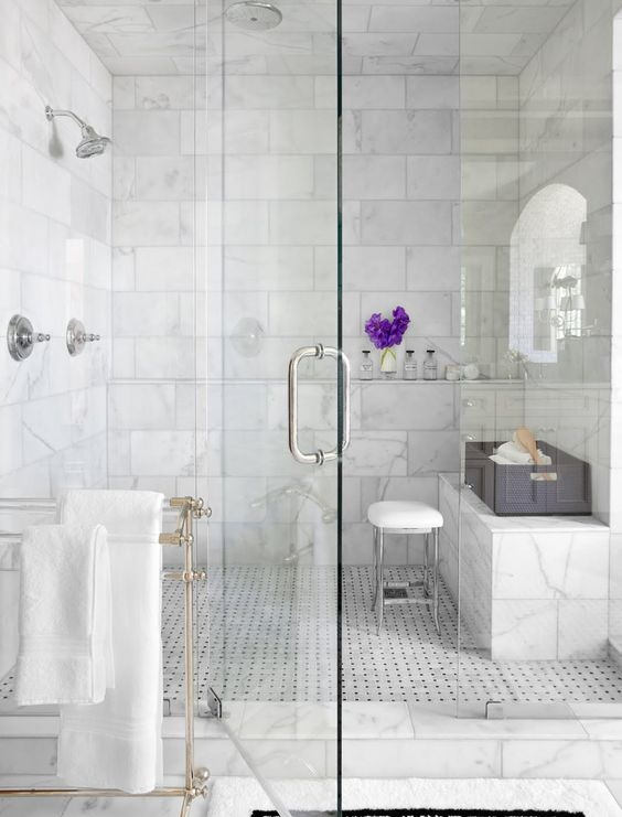 Marble Step-in Shower with Silver Fixtures and Purple Flowers