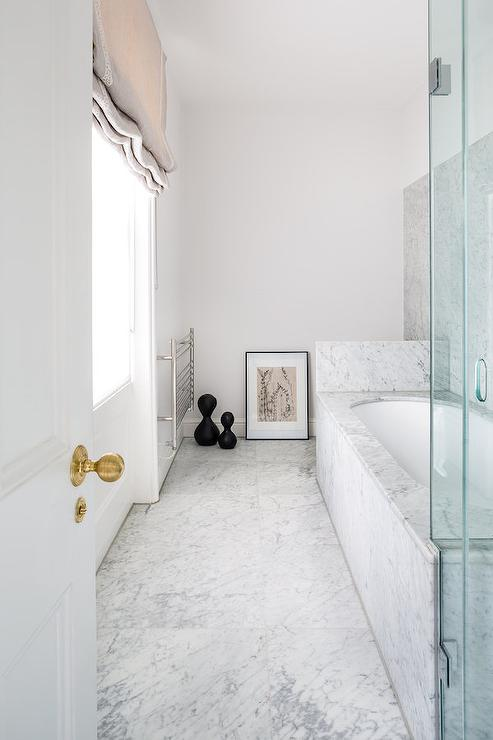 Marble Tub and Door with Brass Knob via Amber Design Group