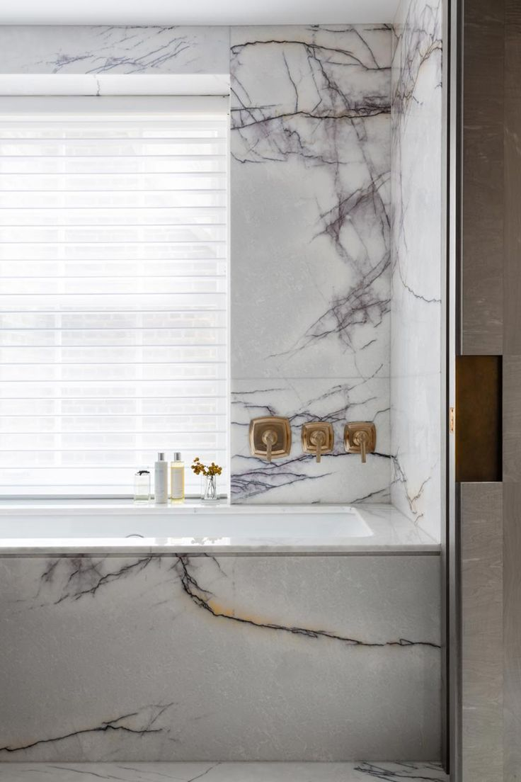 Marble Tub and Wall with Brass Fixtures