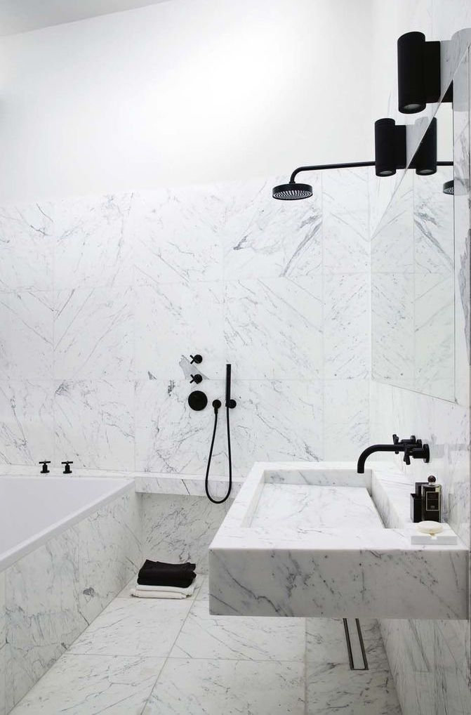 Marble bathroom with black lights and fixtures