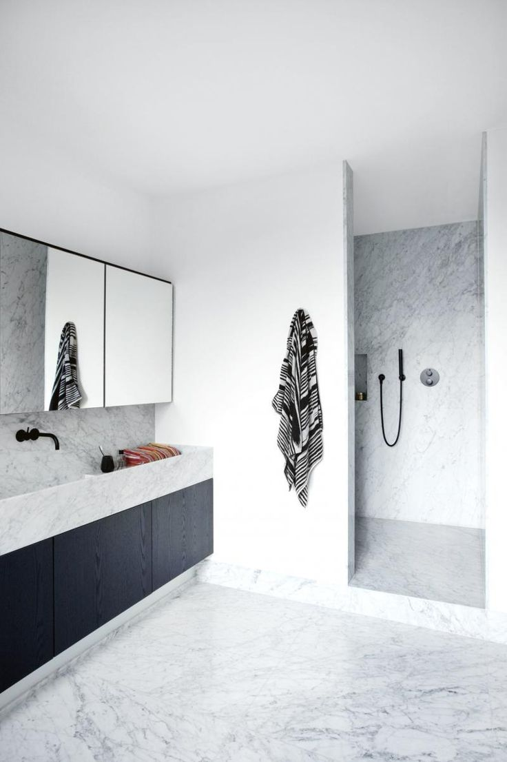 Minimal Marble Bathroom with Black Cabinets