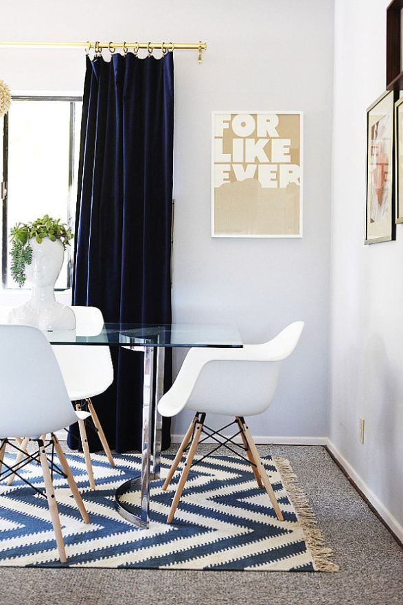 Navy Blue Curtains with Glass Table and White Chairs