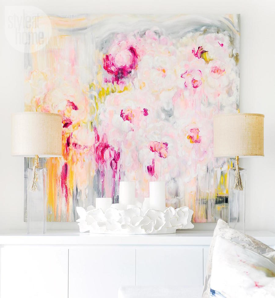 Pastel Pink and Orange Abstract Artwork on White Sideboard