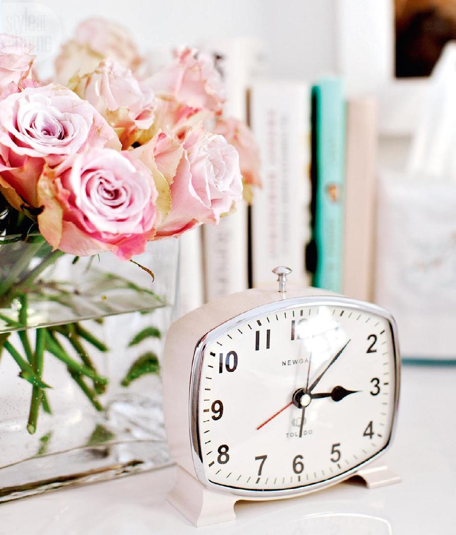 Pink roses and vintage alarm clock