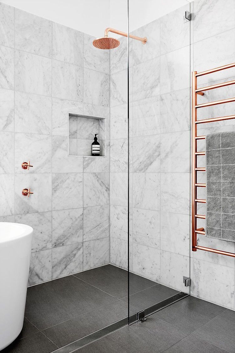 Rose Gold Fixtures and Rack in Marble Shower