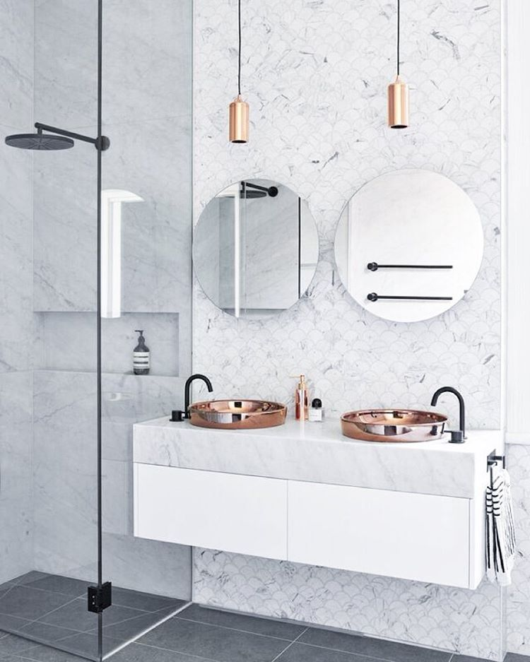 Rose Gold Sink In A Marble Bathroom