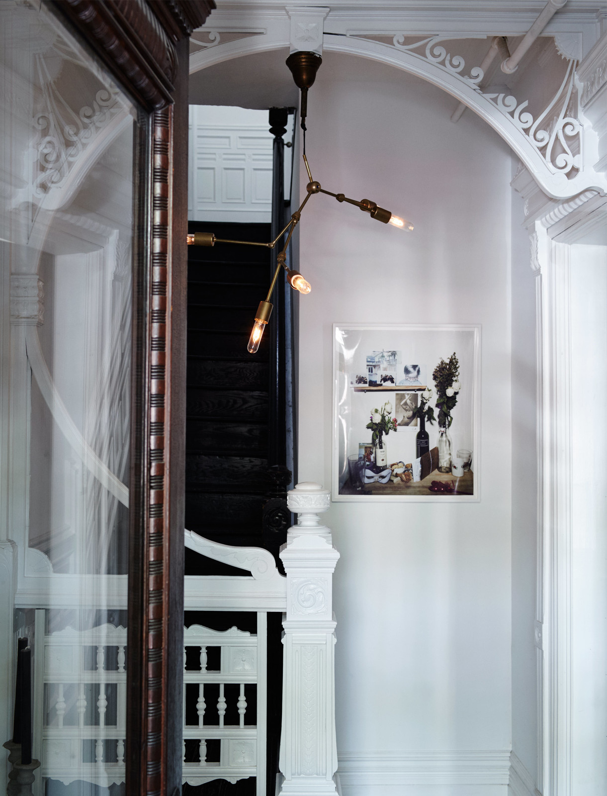 White Iron Frame Doorway with Brass Ceiling Light in Brooklyn
