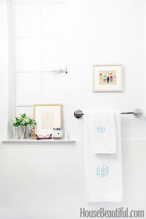 White bathroom with monogrammed towels