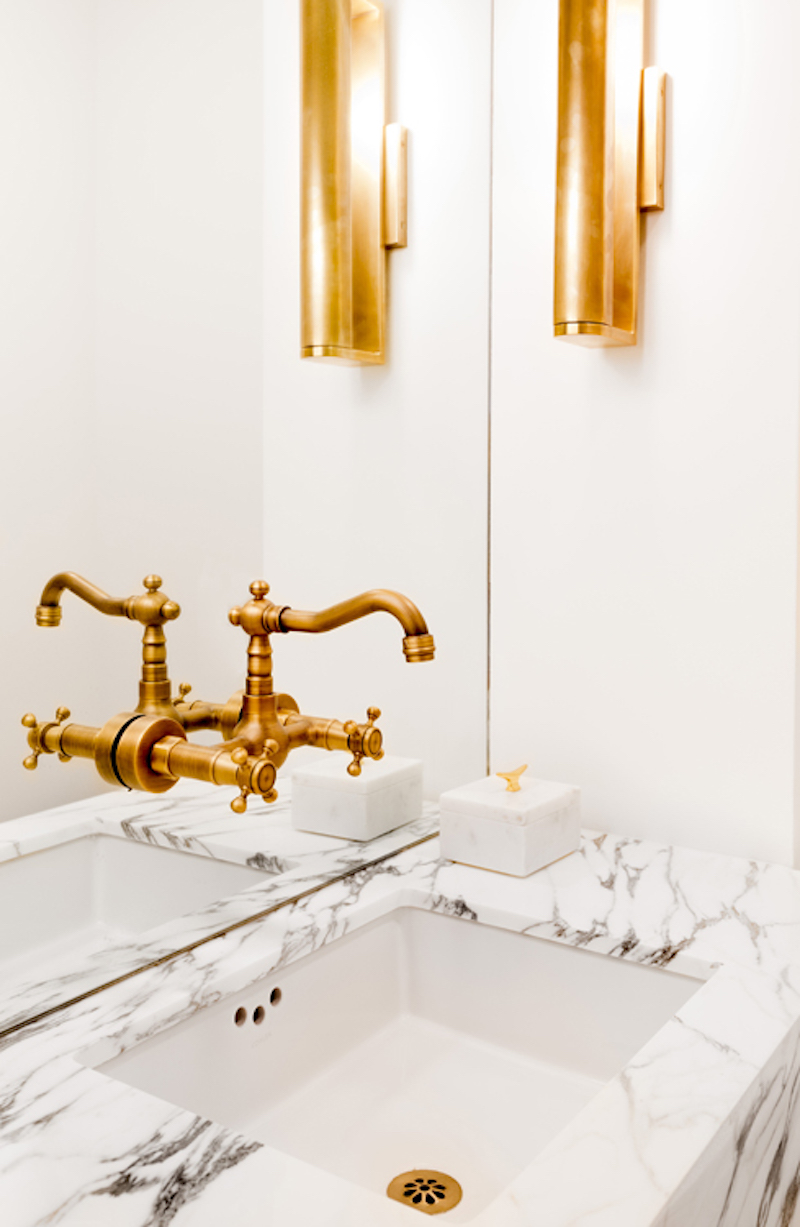 Bathroom with marble vanity and gold fixtures