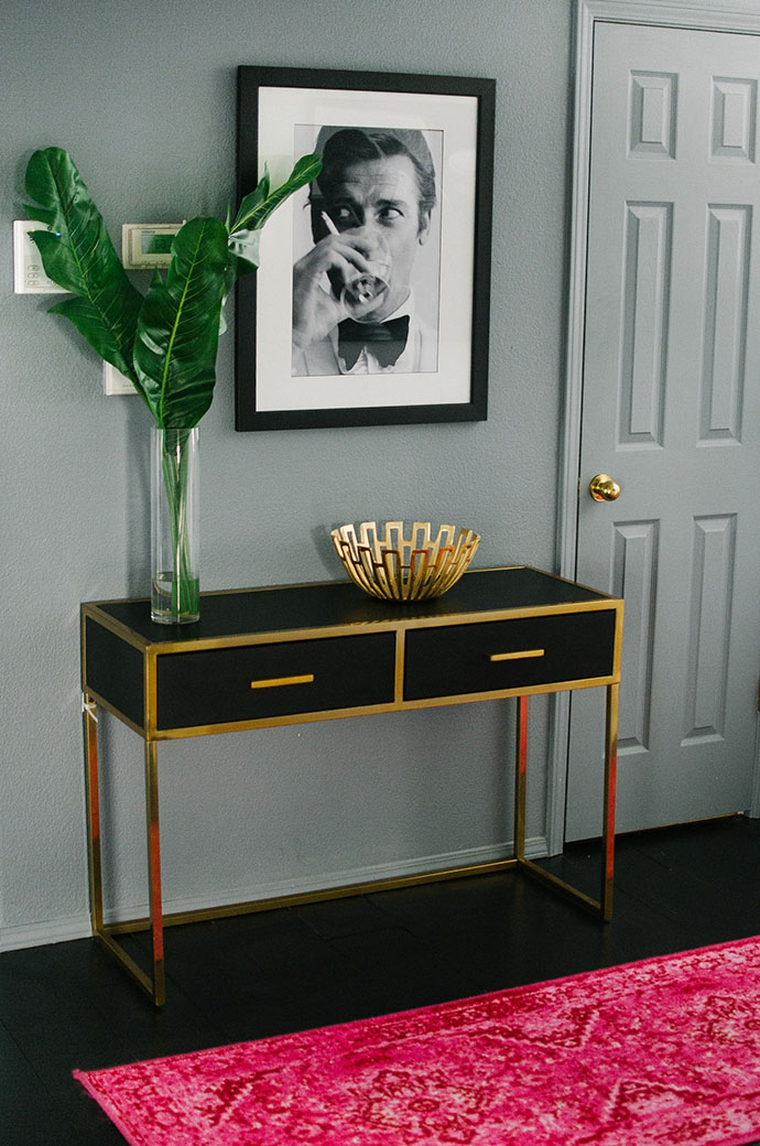Black and gold console table entryway