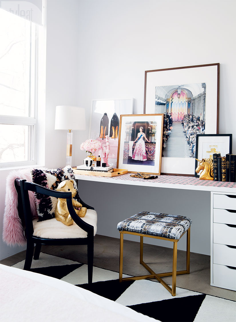 Black chair and gold stool in a regal bedroom