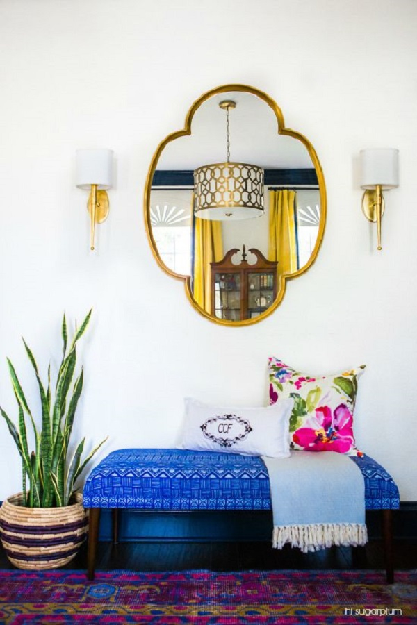 Blue bench Entryway with plants and gold mirror via hisugarplumsblog