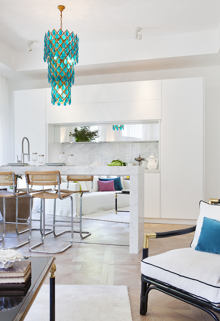Blue crystal chandelier kitchen design by Beatriz Silveira