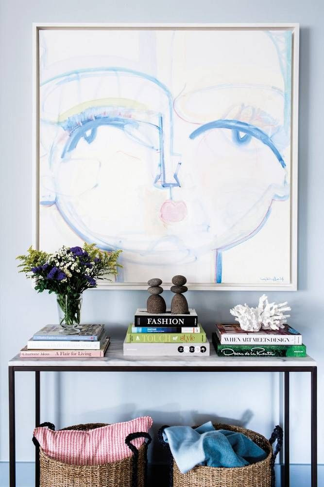 Blue face artwork by Sally King Benedict in a chic Entryway