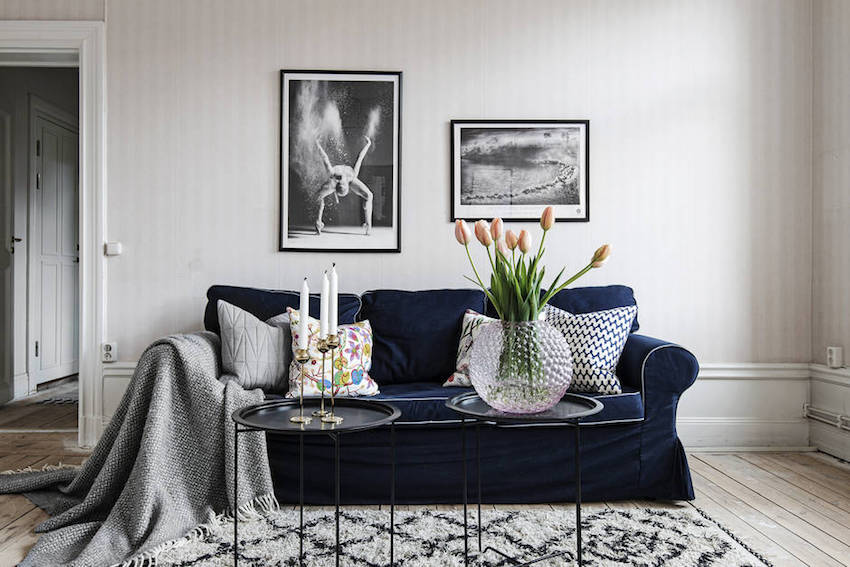 Blue sofa in Scandinavian living room