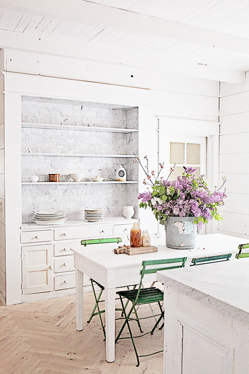 Dining Nook with purple flowers and marble shelving