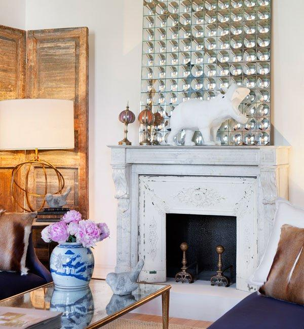 Distressed white fireplace, design by Beatriz Silveira