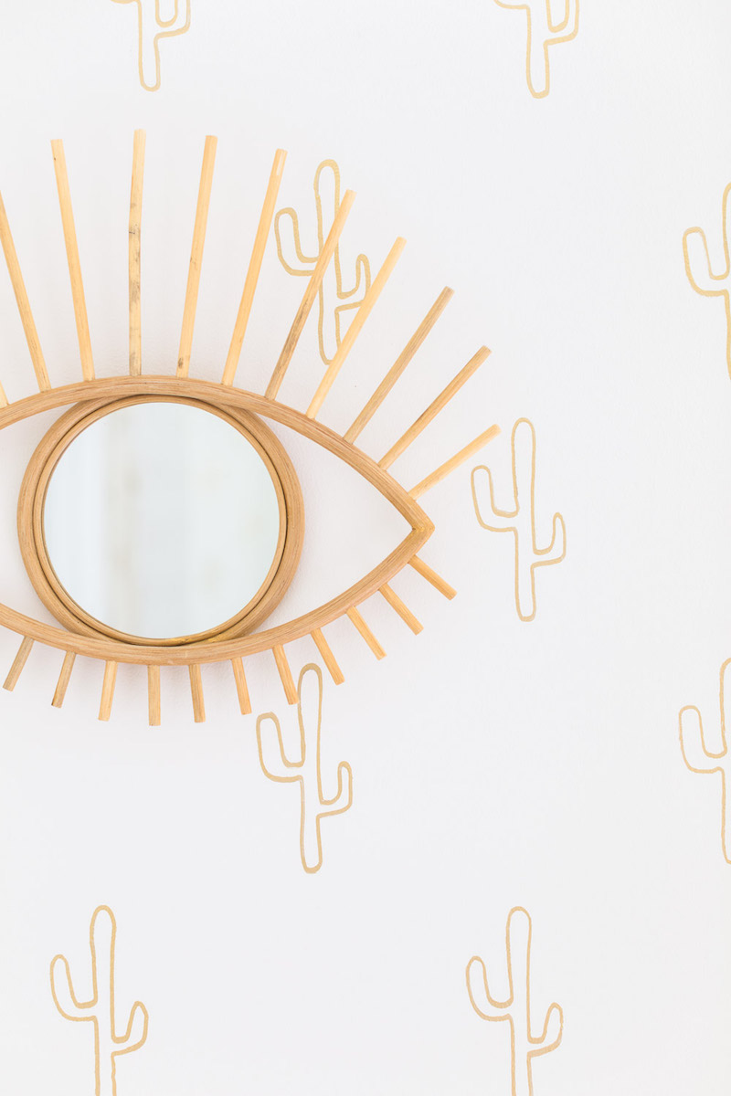 Eye mirror and gold cactus wallpaper