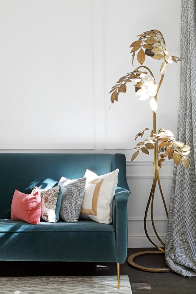 Faded blue velvet sofa with golden tree sculpture, design by Kitchen with marble island, cactus and old painting, design by Beatriz Silveira