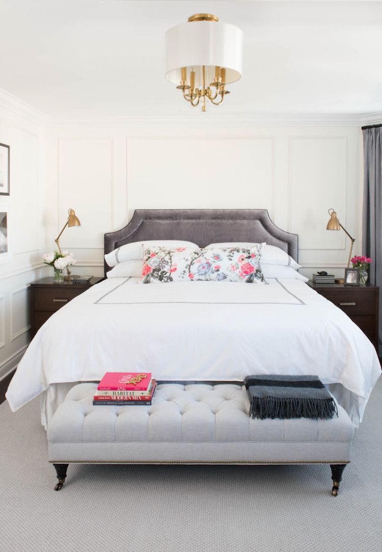 Floral pillowcase on white bed in parisian bedroom
