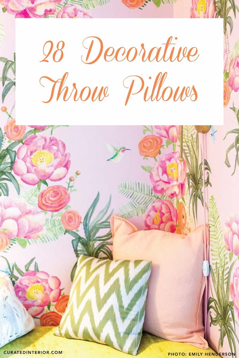 Floral wallpaper with green and pink pillows
