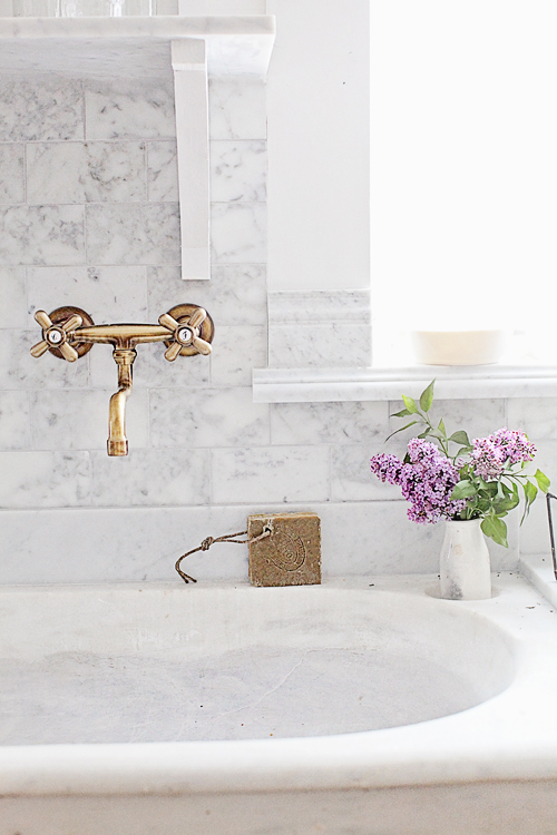 French sink with brass fixtures