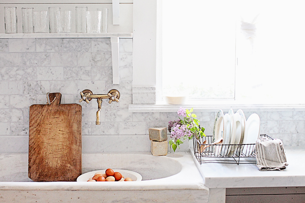 French sink with wooden cutting board