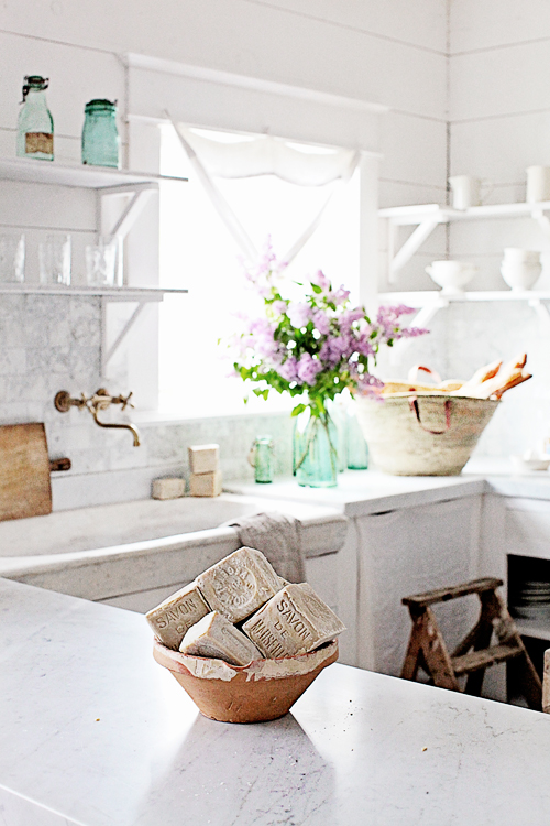 French soap on white marble counters