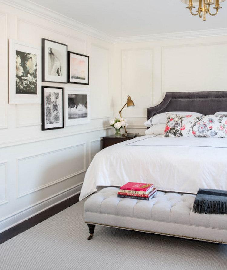 Gallery wall in parisian bedroom