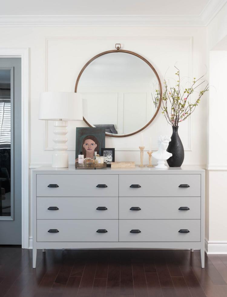 Grey dresser in Parisian bedroom