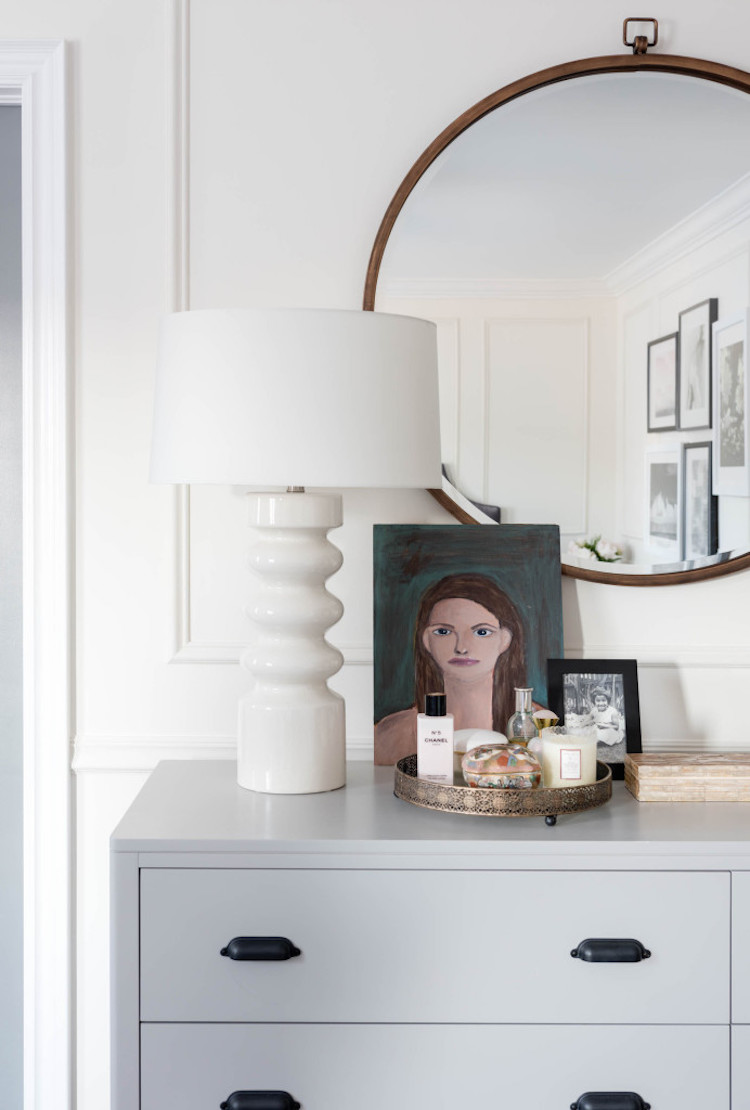 Grey dresser with white lamp
