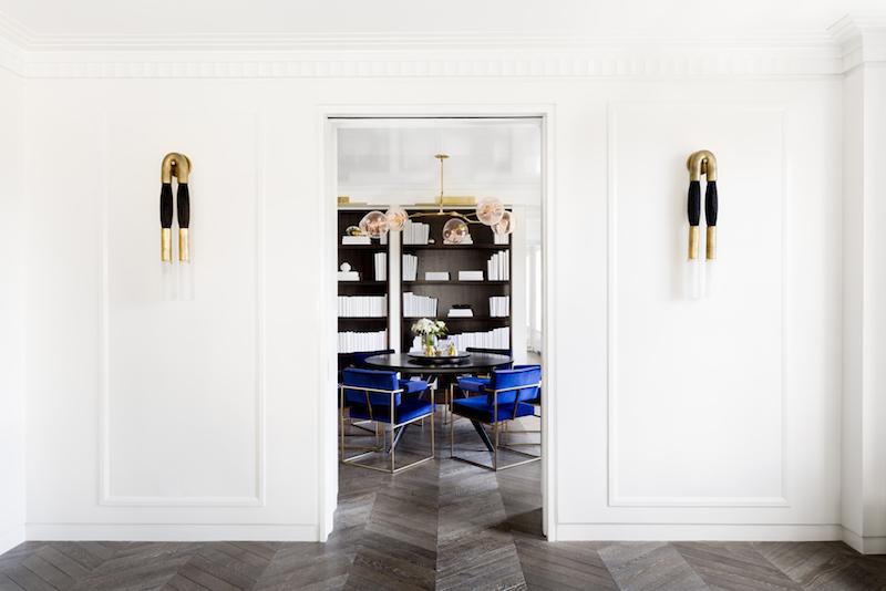 Herringbone dark floors with view into dining room